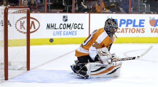 Philadelphia Flyers' Ilya Bryzgalov, of Russia, cannot stop a goal by Florida Panthers' Jack Skille during the first period of an NHL hockey game, Thursday, Feb. 7, 2013, in Philadelphia. (AP Photo/Matt Slocum)