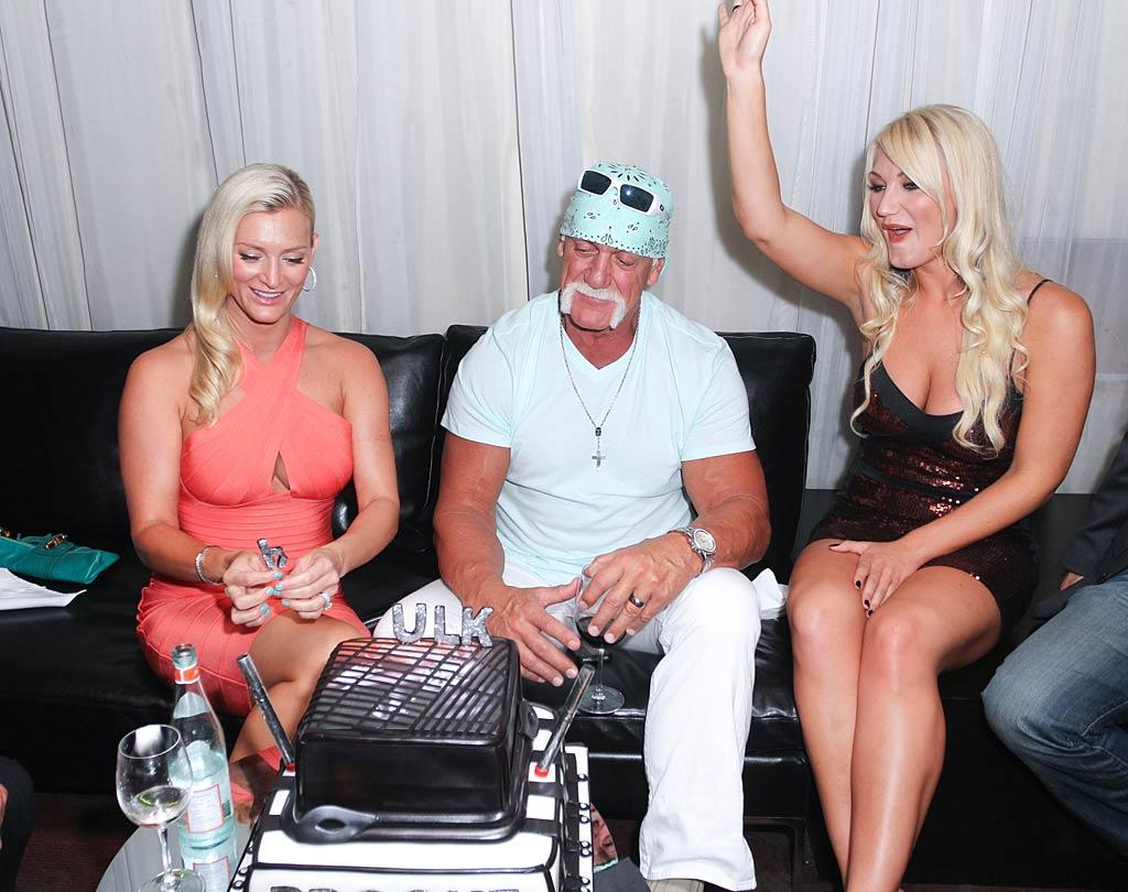 """Thursday also happened to be Hulk's 58th birthday, so he partied it up with his two favorite ladies and a cake in the shape of a ... we can't figure it out, can you? John Parra/<a href=""""http://www.wireimage.com"""" target=""""new"""">WireImage.com</a> - August 11, 2011"""