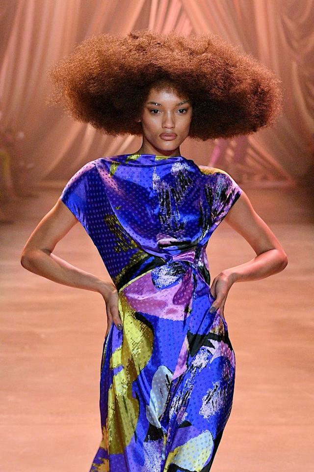 <p>From the sharp, bold suiting reminiscent of grandma's finest church get-ups to the exaggerated silhouettes of the ballroom, Christopher John Rogers brought the drama. But it was especially hard to peel our eyes off the show's choppy yet structural, voluminous afros and old Hollywood curls.</p>
