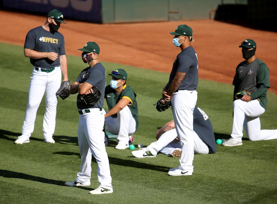"OAKLAND, CA - JULY 14: <a class=""link rapid-noclick-resp"" href=""/mlb/teams/oakland/"" data-ylk=""slk:Oakland Athletics"">Oakland Athletics</a> players wear masks during their Summer Camp at the Coliseum in Oakland, Calif., on Tuesday, July 14, 2020. (Jane Tyska/Digital First Media/East Bay Times via Getty Images)"