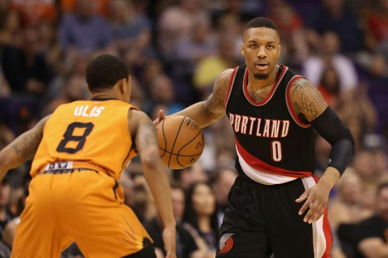 Portland led by 23 points just 10 minutes into the game against Atlanta and rolled to victory behind 27 points from Damian Lillard (R) and 22 from fellow guard CJ McCollum