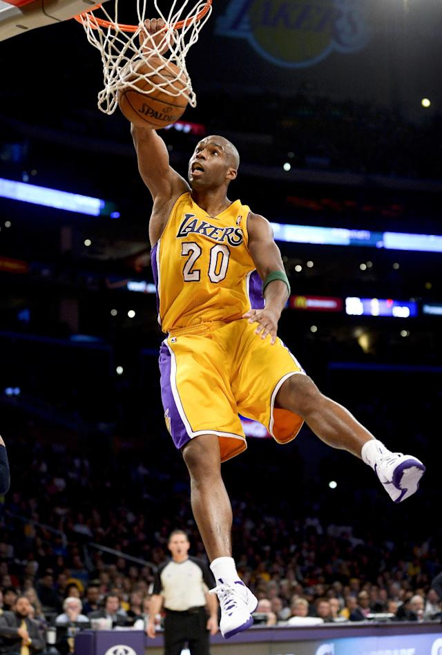 Los Angeles Lakers guard Jodie Meeks dunks on a fast break in the first half of an NBA basketball game against the Dallas Mavericks, Friday, April 4, 2014, in Los Angeles. (AP Photo/Gus Ruelas)