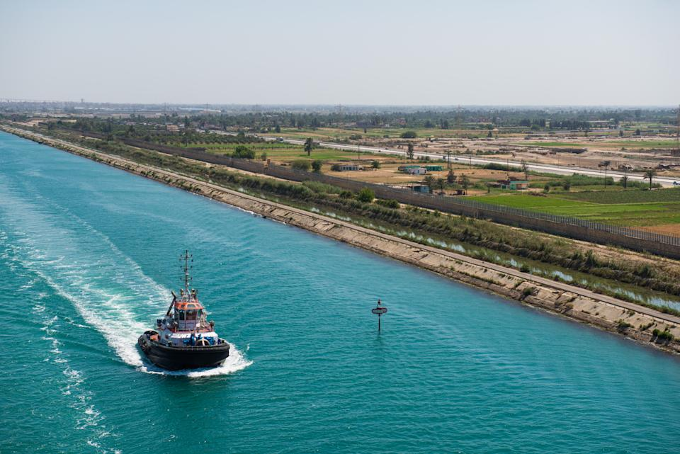 The Suez Canal is an artificial sea-level waterway in Egypt, connecting the Mediterranean Sea to the Red Sea through the Isthmus of Suez. Constructed by the Suez Canal Company between 1859 and 1869, it was officially opened on November 17, 1869.