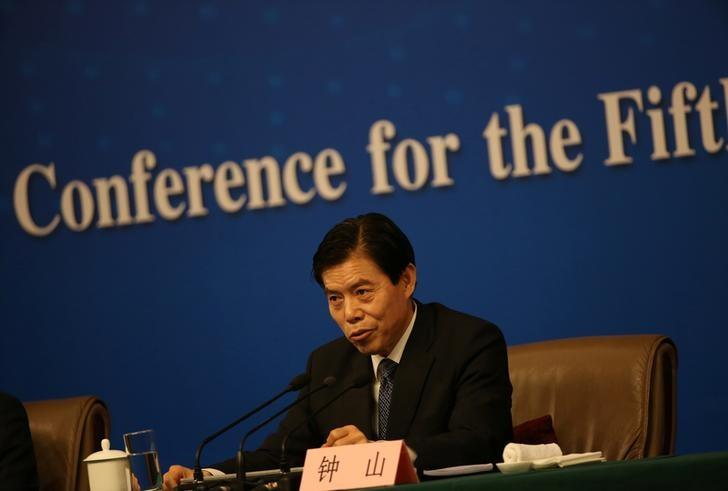 China's Commerce Minister Zhong Shan attends a news conference on the sidelines of China's National People's Congress (NPC) in Beijin