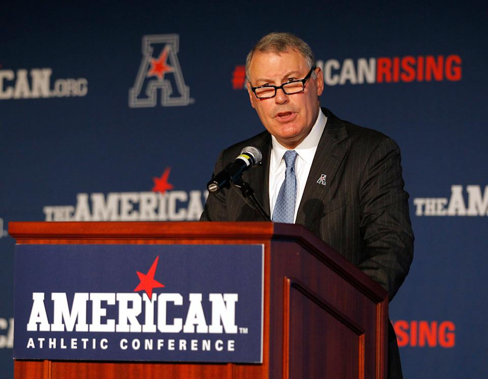 """Athletic Conference Commissioner Mike Aresco denied that his league has ever """"plotted"""" with ESPN to undermine the Big 12 by poaching its schools."""