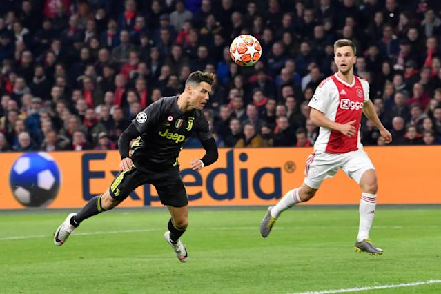 Cristiano Ronaldo scores against Ajax on Wednesday in the Champions League. (Associated Press)