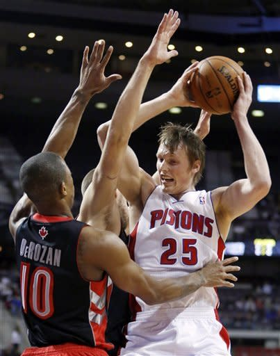 Toronto Raptors guard DeMar DeRozan (10) puts the pressure on Detroit Pistons forward Kyle Singler (25) in the first half of an NBA basketball game, Friday, Nov. 23, 2012, in Auburn Hills, Mich. (AP Photo/Duane Burleson)