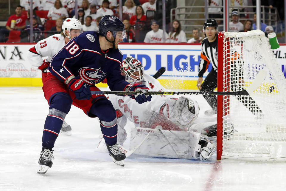 Columbus Blue Jackets' Pierre-Luc Dubois (18) gets his shot past Carolina Hurricanes goaltender James Reimer (47) for a goal during the third period of an NHL hockey game in Raleigh, N.C., Saturday, Oct. 12, 2019. (AP Photo/Karl B DeBlaker)