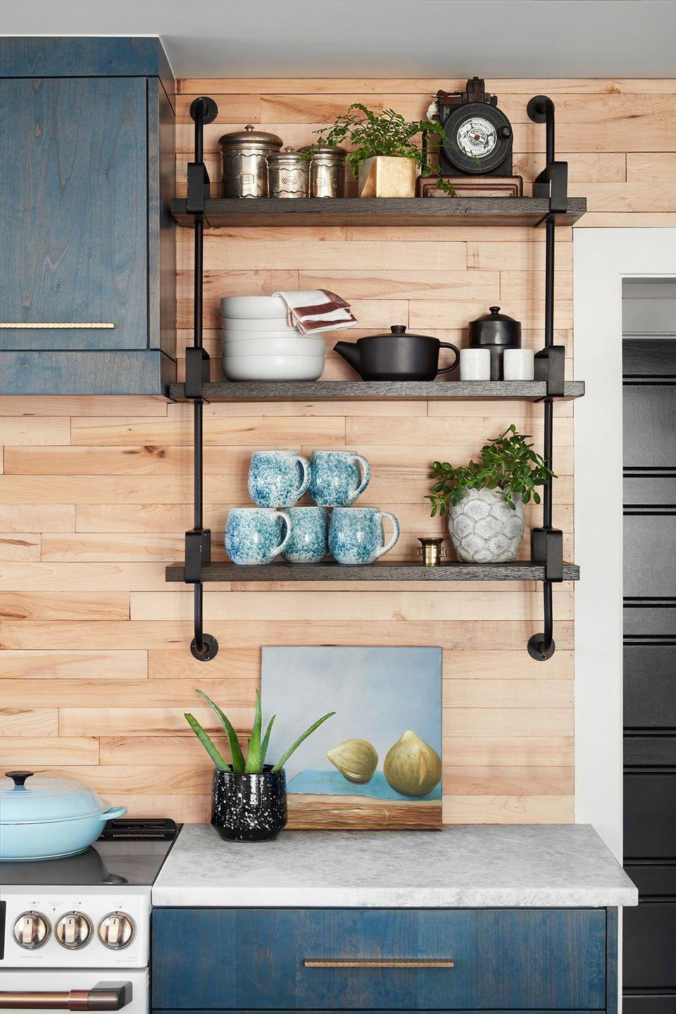 <p>Planed salvaged basketball court floor boards make for a striking backsplash in this kitchen designed by Grace Mitchell of HGTV's One of a Kind.</p>