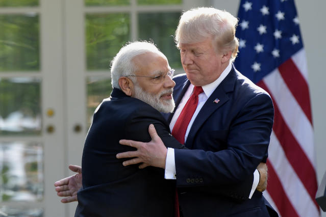 FILE - In this June 26, 2017 file photo, U.S. President Donald Trump and Indian Prime Minister Narendra Modi, left, hug while making statements in the Rose Garden of the White House in Washington. Indian Prime Minister Narendra Modi's party claimed it had won re-election with a commanding lead in vote count Thursday, May 23, 2019. Like President Donald Trump, to whom he is often compared, Modi is a big fan of Twitter and uses a YouTube channel to bypass traditional media. (AP Photo/Susan Walsh, File)