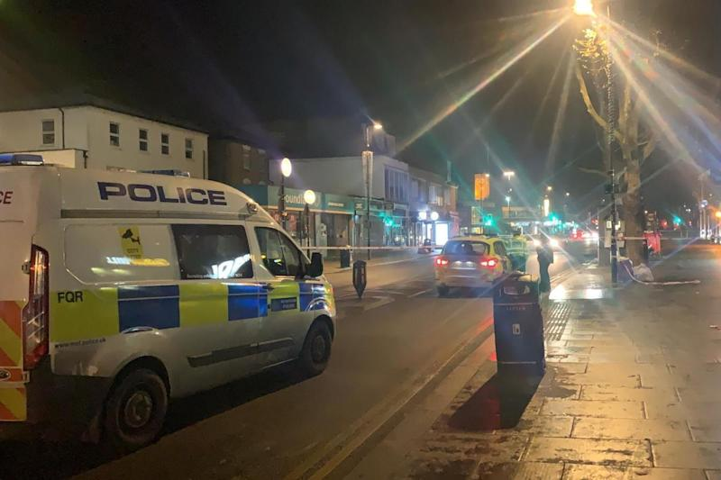 Shooting: police vehicles line the street following the incident near Turnpike Lane station