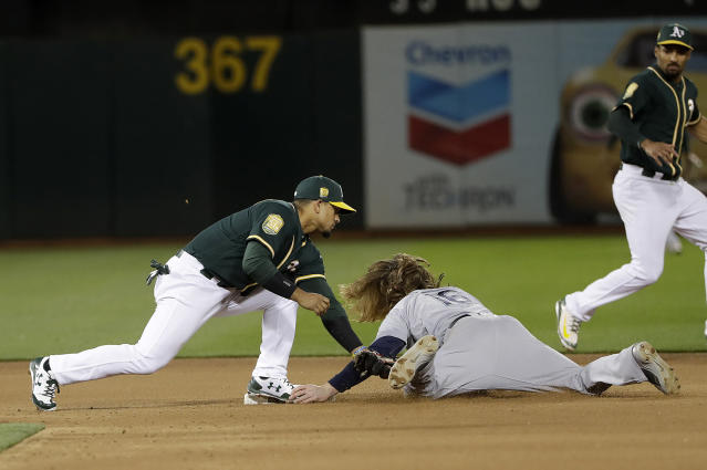 Seattle Mariners' Ben Gamel, right, steals second base next to Oakland Athletics' Franklin Barreto during the seventh inning of a baseball game in Oakland, Calif., Wednesday, May 23, 2018. (AP Photo/Jeff Chiu)