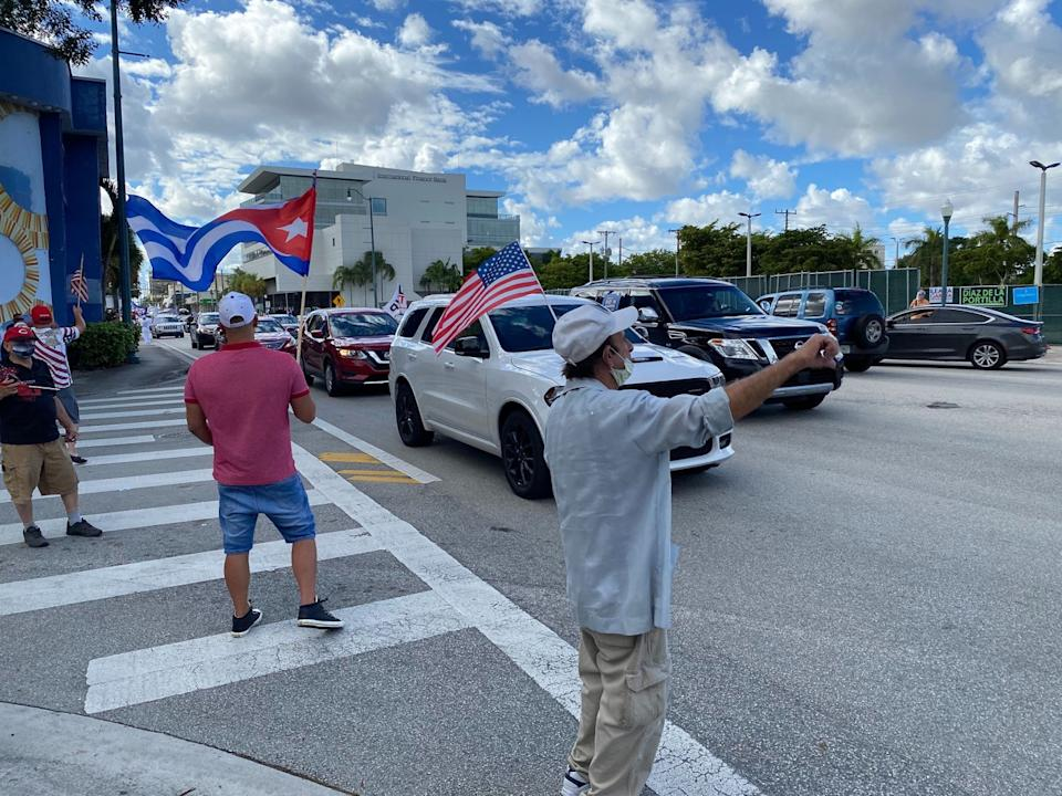 On a recent Sunday, a stretch of cars in a Biden caravan were decorated with Biden/Harris signs.