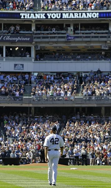 New York Yankees relief pitcher Mariano Rivera walks onto the field from the bullpen for a pregame ceremony at Yankees Stadium before a baseball game against the San Francisco Giants, Sunday, Sept. 22, 2013, in New York. The 13-time All-Star closer is retiring at the end of this season. (AP Photo/Kathy Willens, Pool)