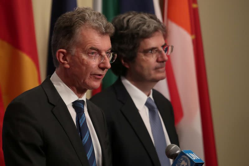 FILE PHOTO: German Ambassador to the United Nations Christoph Heusgen (L) speaks to the media after a U.N. Security Council meeting in New York