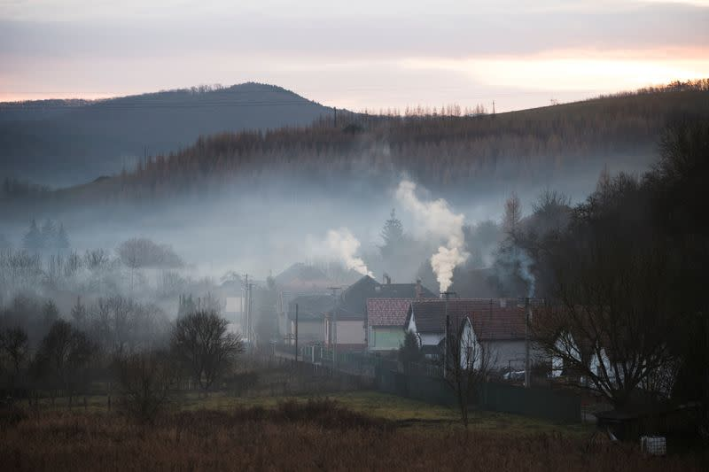 The Wider Image: Hungary's poor burn plastic bottles to stay warm, creating deadly smog