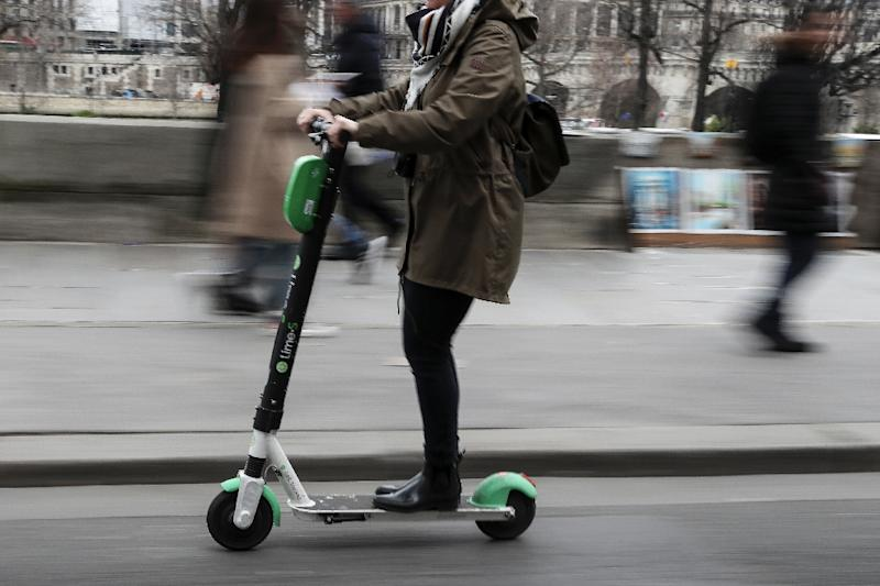 Electric scooters first appeared on the streets of Paris a year ago and have since become a huge headache for the authorities (AFP Photo/KENZO TRIBOUILLARD)