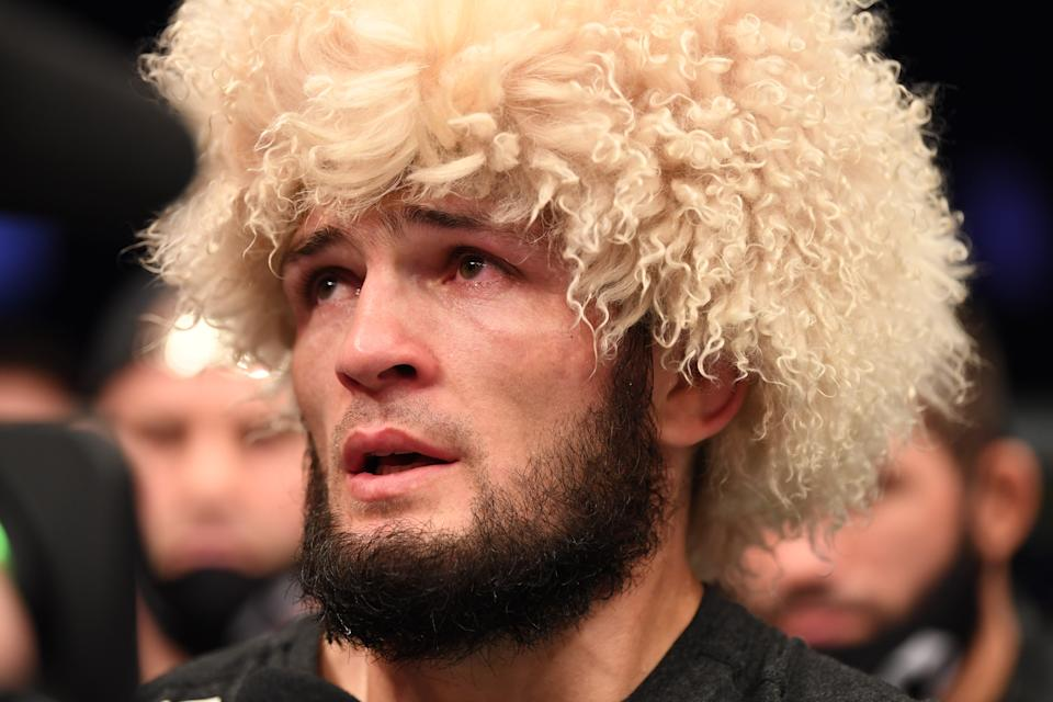 Khabib Nurmagomedov announces his retirement in the Octagon after his victory over Justin Gaethje in their lightweight title bout during the UFC 254 event on October 25, 2020 on UFC Fight Island, Abu Dhabi, United Arab Emirates.