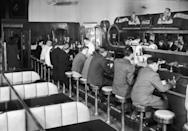 """<p><a href=""""http://dinerdon.com/history/index.html"""" rel=""""nofollow noopener"""" target=""""_blank"""" data-ylk=""""slk:Female employees"""" class=""""link rapid-noclick-resp"""">Female employees</a> became an essential part of the diner experience before World War II ended, and were often seen working at the counter. <br></p>"""
