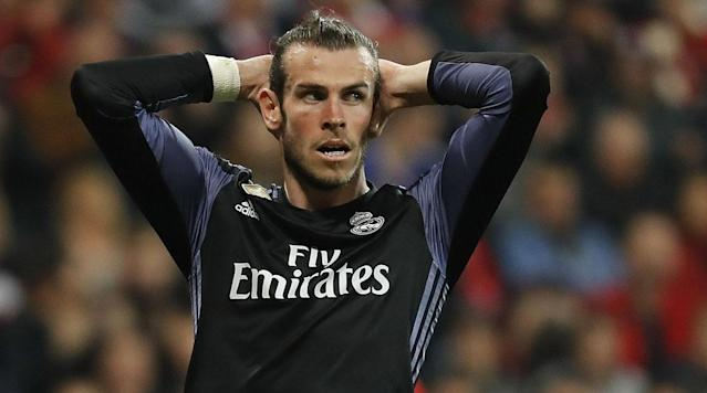 <p>MADRID (AP) – Real Madrid will be without Gareth Bale in its Champions League quarterfinal against Bayern Munich on Tuesday.</p><p>Coach Zinedine Zidane said the forward has not fully recovered from a muscle injury in his right leg and will miss the second leg match at Santiago Bernabeu Stadium. Defending champion Madrid defeated Bayern 2-1 last week in Munich.</p><p>''He will not play because we don't want to take any risks,'' Zidane said on Monday. ''He wants to come back, he has been working hard. Hopefully he will be back for the Clasico (against Barcelona) but it's not certain yet. We will see how he progresses day by day.''</p><p>Madrid hosts Barcelona in the Spanish league on Sunday in a key game for the title race. Madrid, seeking its first league title since 2012, has a three-point lead and a game in hand.</p><p>Bale had to be substituted in the second half of the match against Bayern and missed the team's Spanish league match at Sporting Gijon on Saturday.</p><p>The Wales forward was out for nearly three months this season after a right ankle injury.</p><p>Zidane did not say who will replace Bale, but Francisco ''Isco'' Alarcon - who scored twice to lead Madrid to a late 3-2 win over Sporting - is expected to start. Among Zidane's other options are Marco Asensio and Alvaro Morata.</p><p>''We'll see how we will play, if we will change our scheme or not,'' Zidane said.</p><p>Bayern coach Carlo Ancelotti said Bale's absence will not give his team much of an advantage.</p><p>''They have plenty of good players to replace Bale,'' Ancelotti said. ''We are not going to worry about that.''</p><p>Cristiano Ronaldo, who scored both first-leg goals for Madrid in Munich, is set to start on Tuesday along with Karim Benzema.</p><p>If Isco or Asensio play, Ronaldo and Benzema would be more isolated up front, while Morata would allow Zidane to keep three true forwards in the attack.</p><p>Robert Lewandowski, who hasn't played since injuring his right shoulder against Borussia Dortmund on April 8, is expected to start for Bayern.</p><p>''Without a doubt he is a great player,'' Madrid defensive midfielder Casemiro said of the Poland striker. But he added: ''Bayern has a lot of quality players and a great squad, we can't worry only about Lewandowski.''</p>