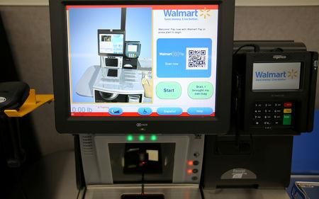 FILE PHOTO: A self checkout kiosk is shown at a new Walmart Super Center prior to its opening in Compton, California, U.S., January 10, 2017.  REUTERS/Mike Blake/File Photo