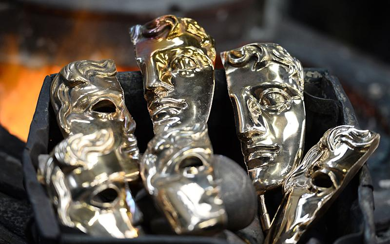 Bronzes faces are readied of the iconic masks cast in to the BAFTA trophy (Credit: Getty Images/Jeff Spicer)