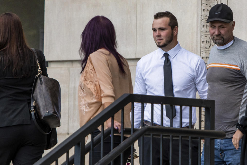 Trevor Gray, 18, second from right, exits the Genesee County Circuit Court, Tuesday, Aug. 3, 2021 in Flint, Mich., after Gray, MarkSekelsky, 19, and Mikadyn Payne, 19, were sentenced to probation for their part in a 2017 rock-throwing incident that killed a motorist on Interstate 75 after spending more than three years in custody while their case was stuck in court. (Isaac Ritchey/The Flint Journal via AP)