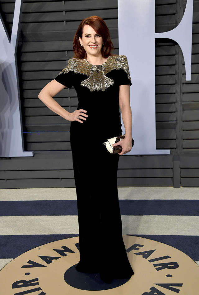 <p>Karen Walker would most certainly approve of Mullaly's chic black dress with a gold embellished bodice. (Photo: Evan Agostini/Invision/AP) </p>