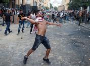 FILE PHOTO: Demonstrators throw stones during a protest in Beirut