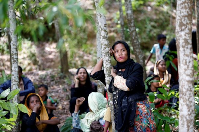 A Rohingya woman looks on after being restricted by the members of Border Guards Bangladesh (BGB) to enter into Bangladesh side, in Cox's Bazar, Bangladesh.
