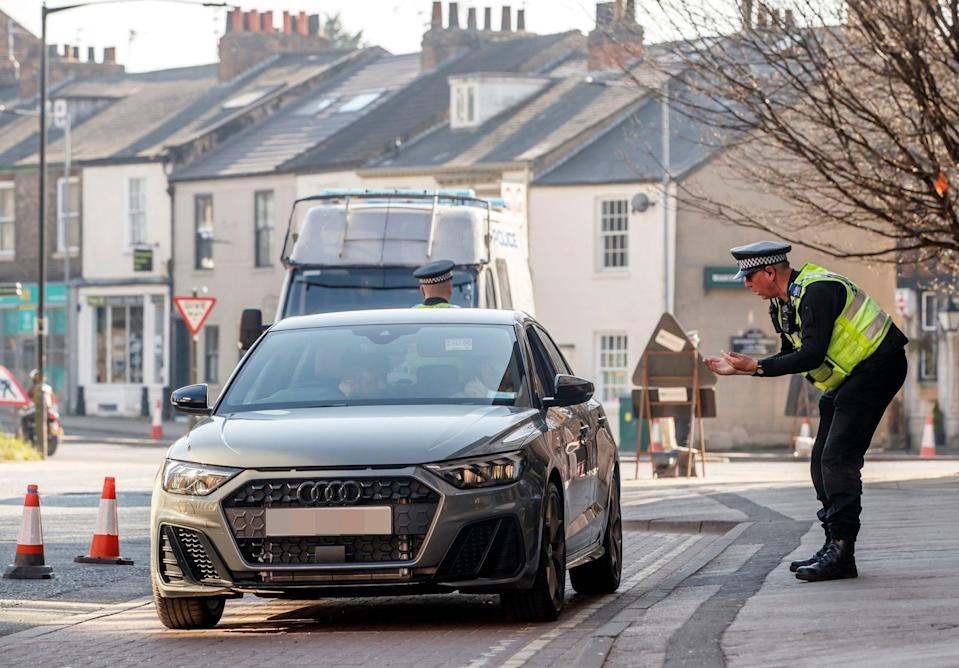 Police at a vehicle checkpoint in York where officers from North Yorkshire Police were ensuring that motorists and their passengers are complying with government restrictions on 26 March (PA)