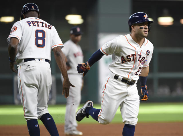 Houston Astros' Jose Altuve (27) hit three home runs in Game 1 of the ALDS vs. Boston. (AP)
