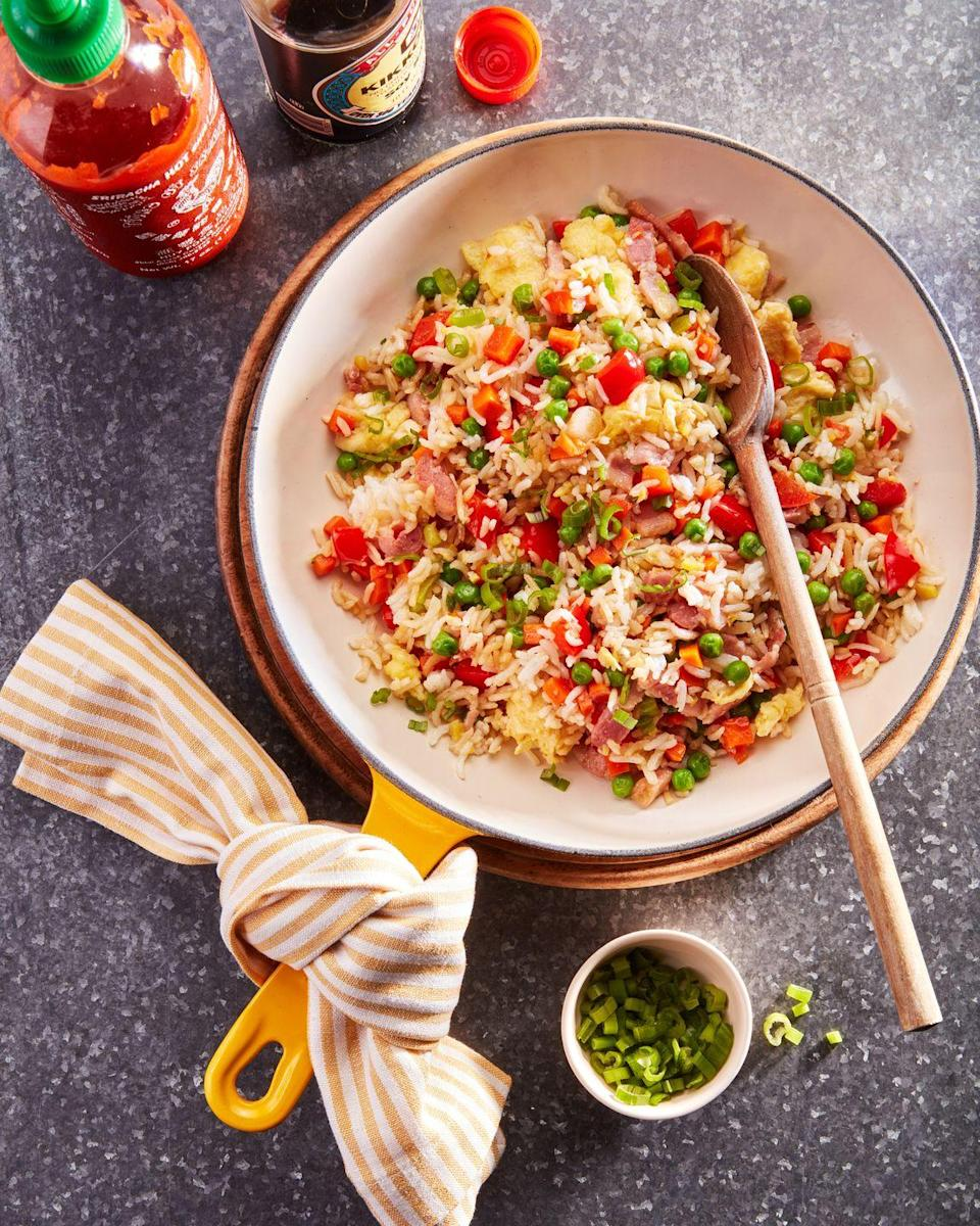 """<p>Keep this endlessly adaptable recipe in your back pocket for the next time you have leftover rice in the fridge. It's delicious. It's easy. And there's just 20 minutes between you and big comforting bowl of it.</p><p><strong><a href=""""https://www.countryliving.com/food-drinks/a36867833/fried-rice/"""" rel=""""nofollow noopener"""" target=""""_blank"""" data-ylk=""""slk:Get the recipe"""" class=""""link rapid-noclick-resp"""">Get the recipe</a>.</strong></p>"""