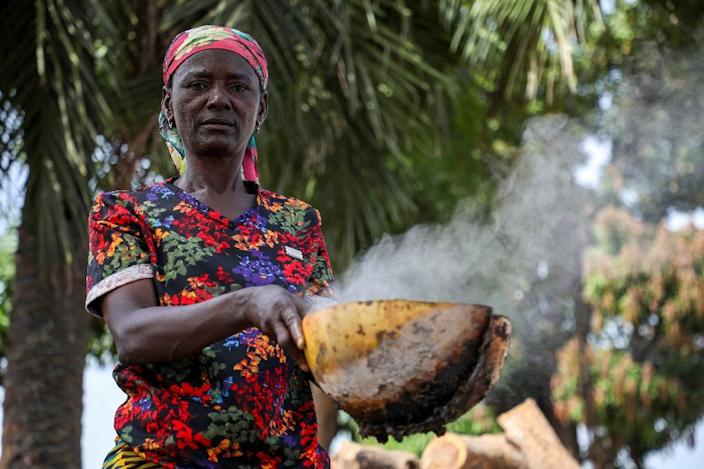 """With money from Nigeria's Conditional Cash Transfer scheme, Ladi Kodi can self- finance her """"black soap"""" production initiative (AFP Photo/Kola SULAIMON)"""