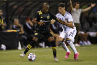 Chicago Fire's Ignacio Aliseda, right, and Columbus Crew's Kevin Molino fight for the ball during the second half of an MLS soccer match Saturday, June 19, 2021, in Columbus, Ohio. (AP Photo/Jay LaPrete)