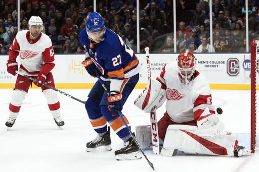 Detroit Red Wings goaltender Jonathan Bernier (45) makes the save against against New York Islanders left wing Anders Lee (27) during the second period of an NHL hockey game, Saturday, Dec. 15, 2018, in Uniondale, N.Y. (AP Photo/Mary Altaffer)