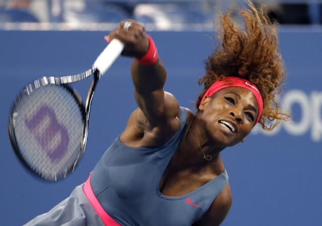 REFILE - ADDING KEYWORDS Serena Williams of the U.S. serves to Carla Suarez Navarro of Spain at the U.S. Open tennis championships in New York September 3, 2013. REUTERS/Shannon Stapleton (UNITED STATES - Tags: SPORT TENNIS TPX IMAGES OF THE DAY)