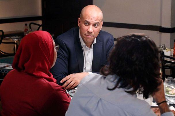 PHOTO: 2020 Democratic presidential candidate Cory Booker has dinner with three undecided voters at a restaurant in Newark, N.J., including Tria Jones, left and Bijan Roghanchi, right. (Lou Rocco/Walt Disney Television)