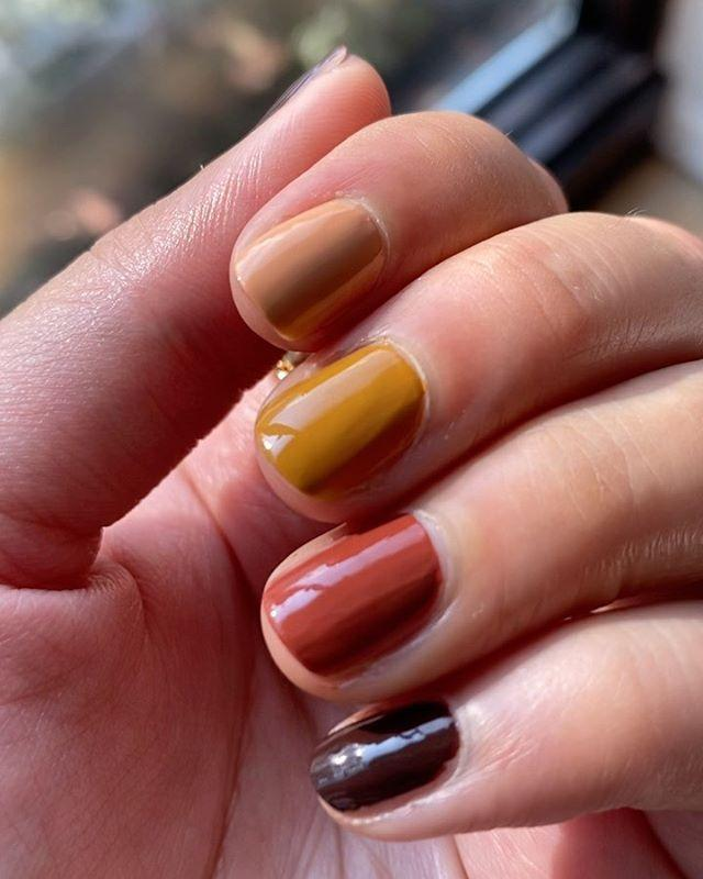 """<p>Give the rainbow manicure trend a twist by incorporating a fall color palette. Double up on the same shade twice, like this deep brown, for a """"I Put A Lot Of Thought Into This"""" look. </p><p><a href=""""https://www.instagram.com/p/CEb-8HtjZXO/"""" rel=""""nofollow noopener"""" target=""""_blank"""" data-ylk=""""slk:See the original post on Instagram"""" class=""""link rapid-noclick-resp"""">See the original post on Instagram</a></p>"""