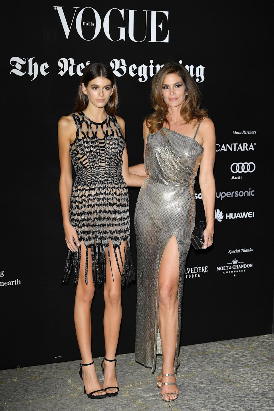 She matched in metallic with her mom for a fashion party during Milan Fashion Week.