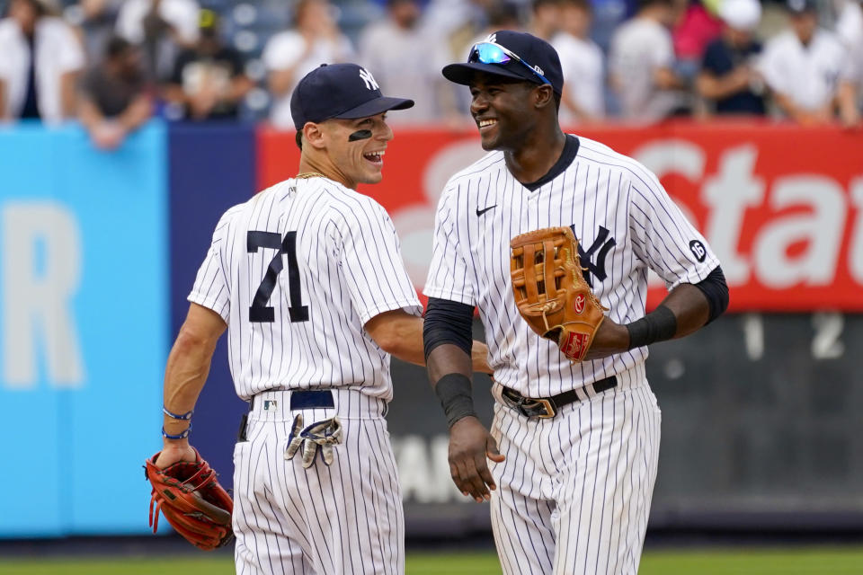 New York Yankees' Andrew Velazquez (71) celebrates with Estevan Forial after they defeated the Minnesota Twins in a baseball game, Saturday, Aug. 21, 2021, in New York. (AP Photo/Mary Altaffer)