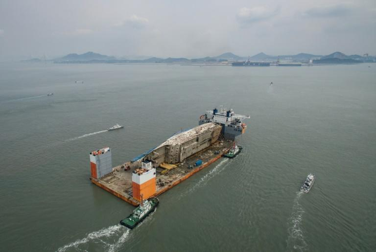 The salvaged wreck of South Korea's Sewol ferry completed its final journey to shore carried by a semi-submersible ship in March