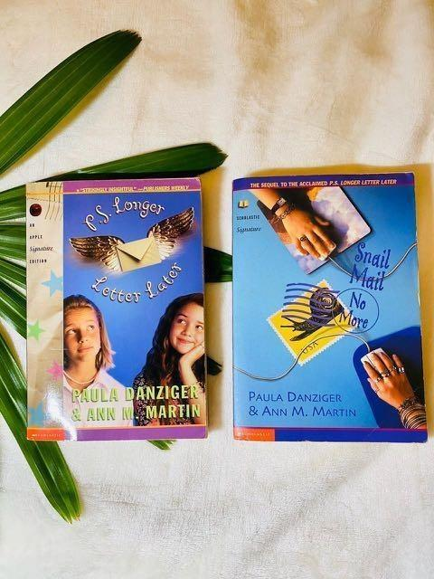 Two books, P.S. Longer Letter Later and Snail Mail No More, both with blue covers; one features two young girls, and one features two hands on mousepads