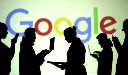 FILE PHOTO: Silhouettes of laptop and mobile device users are seen next to a screen projection of Google logo in this picture illustration taken March 28, 2018. REUTERS/Dado Ruvic/Illustration/File Photo