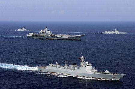 China's aircraft carrier Liaoning takes part in a military drill of Chinese People's Liberation Army (PLA) Navy in the western Pacific Ocean