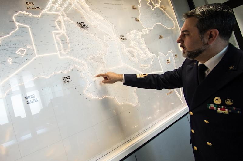 Italian Coastgurad officer Gianluca Dagostino looks at a map of the Mediterranean Sea, in the control center at the headquarters of Italian Coastguard, on May 28 2015, in Rome (AFP Photo/Andreas Solaro)