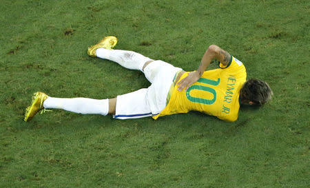 Brazil's Neymar holds his back after being injured in his 2014 World Cup quarter-final match against Colombia in Fortaleza