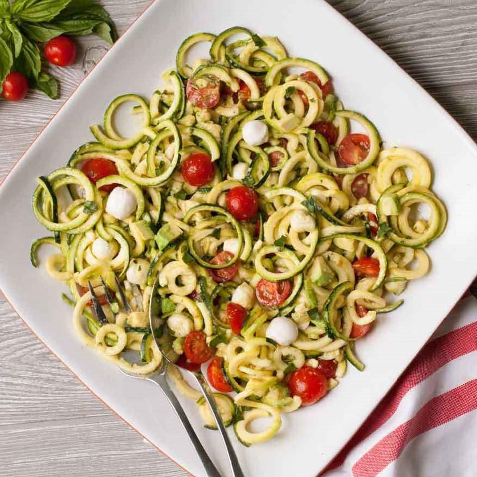 <p>Spiralized zucchini noodles make the perfect base for this colorful and flavorful salad--think pasta salad without all the carbs! It comes together quickly for a light lunch or easy side. Add grilled chicken, shrimp or chickpeas to make a heartier meal.</p>