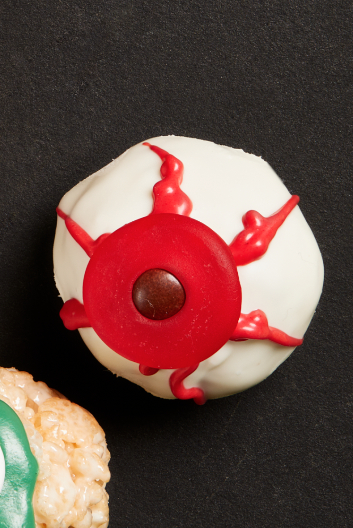 """<p>Few things are better than a doughnut hole... except maybe a doughnut hole covered in chocolate and decorated like a spooky eyeball. </p><p><strong><em>Get the recipe at <a href=""""https://www.thepioneerwoman.com/food-cooking/recipes/a32127337/doughnut-hole-eyeballs-recipe/"""" rel=""""nofollow noopener"""" target=""""_blank"""" data-ylk=""""slk:The Pioneer Woman"""" class=""""link rapid-noclick-resp"""">The Pioneer Woman</a>.</em></strong></p>"""