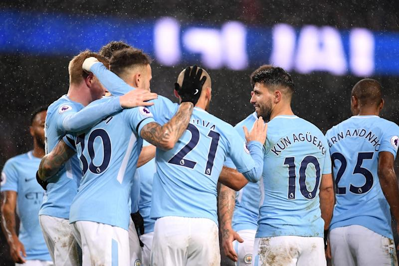 David Silva celebrates Sergio Aguero's goal with the rest of his Manchester City team-mates: Laurence Griffiths/Getty Images